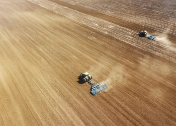 Aerial view Tractors preparing field, Agriculture tractors landscape